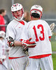 Baldwinsville Bees Charlie Bertrand (6) gets congratulated for his goal against the Auburn Maroons by Peter Fiorni III (13) in Section III Boys Lacrosse action at the Pelcher-Arcaro Stadium in Baldwinsville, New York on Monday, May 2, 2016.  Baldwinsville won 16-6.