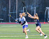 Cicero-North Syracuse Northstars Jessica Meneilly (11) running with the ball against past West Genesee Wildcats Kyra Bednarski (25) in Section III Girls Lacrosse action at Bragman Stadium in Cicero, New York on Thursday, May 5, 2016.  West Genesee won 9-5.