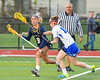 West Genesee Wildcats Mackenzie Baker (8) looking to make a play against the Cicero-North Syracuse Northstars in Section III Girls Lacrosse action at Bragman Stadium in Cicero, New York on Thursday, May 5, 2016.  West Genesee won 9-5.