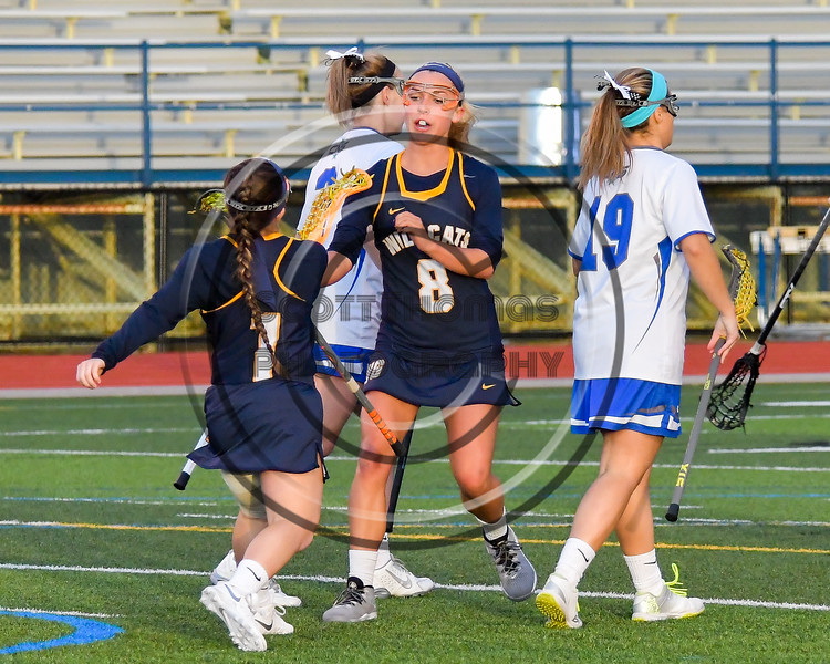 West Genesee Wildcats Mackenzie Baker (8) celebrates her goal against the Cicero-North Syracuse Northstars in Section III Girls Lacrosse action at Bragman Stadium in Cicero, New York on Thursday, May 5, 2016.  West Genesee won 9-5.