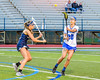 Cicero-North Syracuse Northstars Lexxi Knoblock (20) passing the ball against West Genesee Wildcats Alexa Meager (4) in Section III Girls Lacrosse action at Bragman Stadium in Cicero, New York on Thursday, May 5, 2016.  West Genesee won 9-5.