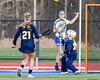 West Genesee Wildcats goalie Mackenzie Kittell (77) makes a save against the Cicero-North Syracuse Northstars in Section III Girls Lacrosse action at Bragman Stadium in Cicero, New York on Thursday, May 5, 2016.  West Genesee won 9-5.