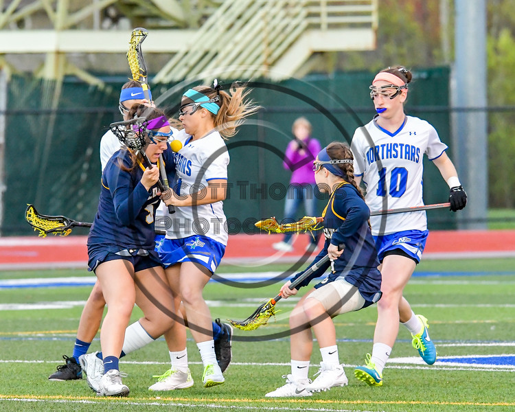 West Genesee Wildcats Nicole Delany (5) has the ball knocked out by a Cicero-North Syracuse Northstars defender in Section III Girls Lacrosse action at Bragman Stadium in Cicero, New York on Thursday, May 5, 2016.  West Genesee won 9-5.