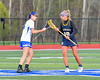 West Genesee Wildcats Ally Trice (19) facing off against Cicero-North Syracuse Northstars Maghan Duffy (16) in Section III Girls Lacrosse action at Bragman Stadium in Cicero, New York on Thursday, May 5, 2016.  West Genesee won 9-5.