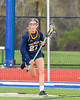 West Genesee Wildcats Emma Parry (27) with the ball against the Cicero-North Syracuse Northstars in Section III Girls Lacrosse action at Bragman Stadium in Cicero, New York on Thursday, May 5, 2016.  West Genesee won 9-5.