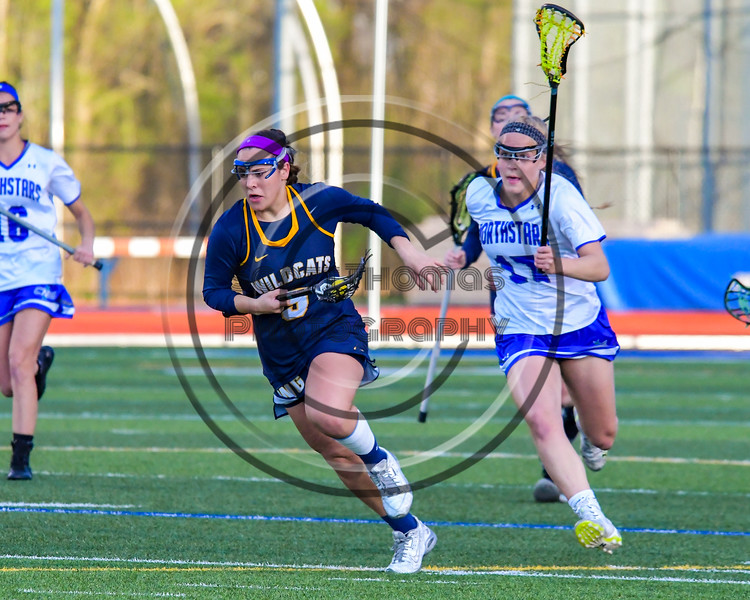 West Genesee Wildcats Nicole Delany (5) running with the ball against the Cicero-North Syracuse Northstars in Section III Girls Lacrosse action at Bragman Stadium in Cicero, New York on Thursday, May 5, 2016.  West Genesee won 9-5.