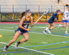 West Genesee Wildcats Alexa Meager (4) running with the ball against the Cicero-North Syracuse Northstars in Section III Girls Lacrosse action at Bragman Stadium in Cicero, New York on Thursday, May 5, 2016.  West Genesee won 9-5.
