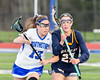 Cicero-North Syracuse Northstars Megan Tryniski (13) rides West Genesee Wildcats Emma Parry (27) who has the ball in Section III Girls Lacrosse action at Bragman Stadium in Cicero, New York on Thursday, May 5, 2016.  West Genesee won 9-5.