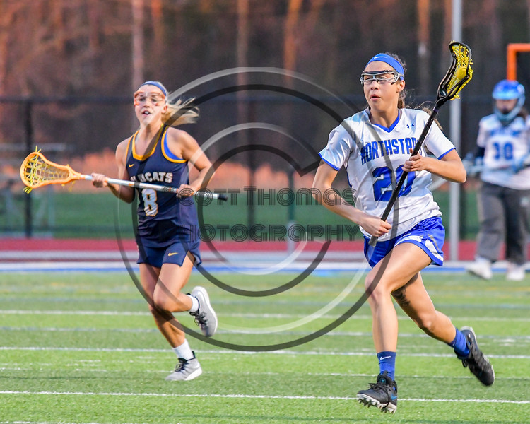 Cicero-North Syracuse Northstars Samantha Tortora (20) running with the ball against the West Genesee Wildcats in Section III Girls Lacrosse action at Bragman Stadium in Cicero, New York on Thursday, May 5, 2016.  West Genesee won 9-5.