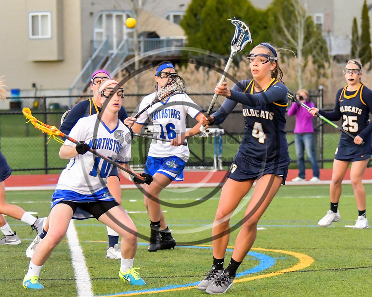 West Genesee Wildcats Alexa Meager (4) passing the ball against Cicero-North Syracuse Northstars Mary Kate Bonanni (10) in Section III Girls Lacrosse action at Bragman Stadium in Cicero, New York on Thursday, May 5, 2016.  West Genesee won 9-5.