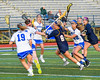 West Genesee Wildcats Mackenzie Baker (8) driving for a goal against the Cicero-North Syracuse Northstars in Section III Girls Lacrosse action at Bragman Stadium in Cicero, New York on Thursday, May 5, 2016.  West Genesee won 9-5.