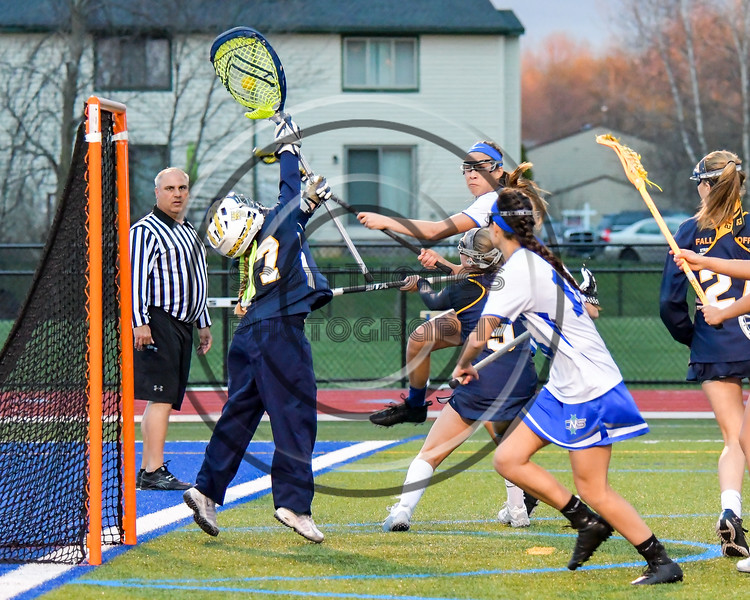 Cicero-North Syracuse Northstars scoring attempt is stopped by West Genesee Wildcats goalie Mackenzie Kittell (77) in Section III Girls Lacrosse action at Bragman Stadium in Cicero, New York on Thursday, May 5, 2016.  West Genesee won 9-5.