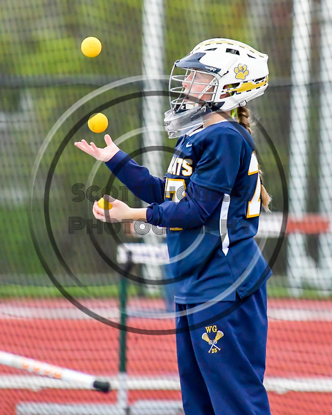 West Genesee Wildcats goalie Mackenzie Kittell (77) juggles lacrosse balls before playing the Cicero-North Syracuse Northstars in Section III Girls Lacrosse action at Bragman Stadium in Cicero, New York on Thursday, May 5, 2016.