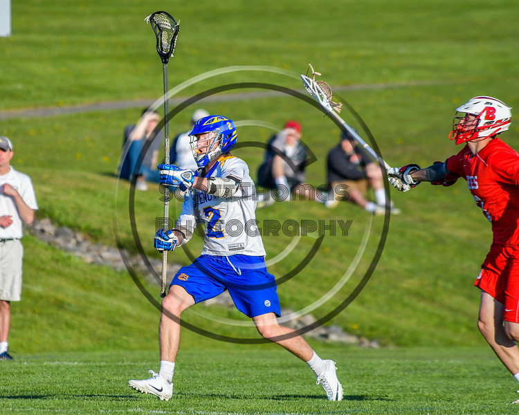 Cazenovia Lakers Adam Race (2) passes the ball against the Baldwinsville Bees in Section III Boys Lacrosse action at the Sean M. Googin Memorial Sports Complex in Cazenovia, New York on Tuesday, May 10, 2016.  Cazenovia won 10-8.