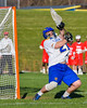 Cazenovia Lakers Brendan Whalen (21) in goal against the Baldwinsville Bees in Section III Boys Lacrosse action at the Sean M. Googin Memorial Sports Complex in Cazenovia, New York on Tuesday, May 10, 2016.  Cazenovia won 10-8.