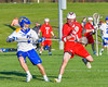 Baldwinsville Bees Peter Fiorni III (13) gets stick checked by Cazenovia Lakers Adam Race (2) in Section III Boys Lacrosse action at the Sean M. Googin Memorial Sports Complex in Cazenovia, New York on Tuesday, May 10, 2016.  Cazenovia won 10-8.