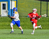 Baldwinsville Bees Ryan Gebhardt (20) chasing after Cazenovia Lakers goalie Brendan Whalen (21) in Section III Boys Lacrosse action at the Sean M. Googin Memorial Sports Complex in Cazenovia, New York on Tuesday, May 10, 2016.  Cazenovia won 10-8.