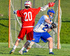 Cazenovia Lakers goalie Brendan Whalen (21) looking to make a play against Baldwinsville Bees Ryan Gebhardt (20) in Section III Boys Lacrosse action at the Sean M. Googin Memorial Sports Complex in Cazenovia, New York on Tuesday, May 10, 2016.  Cazenovia won 10-8.