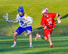 Baldwinsville Bees Kyle Pelcher (29) defending against Cazenovia Lakers Thomas Bragg (9) in Section III Boys Lacrosse action at the Sean M. Googin Memorial Sports Complex in Cazenovia, New York on Tuesday, May 10, 2016.  Cazenovia won 10-8.