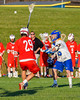 Cazenovia Lakers Jake Stowell (15) passing the ball against Baldwinsville Bees Kyle Pelcher (29) in Section III Boys Lacrosse action at the Sean M. Googin Memorial Sports Complex in Cazenovia, New York on Tuesday, May 10, 2016.  Cazenovia won 10-8.