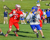 Baldwinsville Bees Matt Dickman (23) defending against Cazenovia Lakers Cole Willard (24) in Section III Boys Lacrosse action at the Sean M. Googin Memorial Sports Complex in Cazenovia, New York on Tuesday, May 10, 2016.  Cazenovia won 10-8.