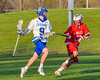 Baldwinsville Bees Kyle Pelcher (29) defendign against Cazenovia Lakers Thomas Bragg (9) in Section III Boys Lacrosse action at the Sean M. Googin Memorial Sports Complex in Cazenovia, New York on Tuesday, May 10, 2016.  Cazenovia won 10-8.