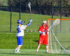 Baldwinsville Bees goalie Riley Smith (35) looking to make a pass against the Cazenovia Lakers in Section III Boys Lacrosse action at the Sean M. Googin Memorial Sports Complex in Cazenovia, New York on Tuesday, May 10, 2016.  Cazenovia won 10-8.
