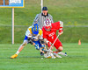 Baldwinsville Bees Ryan ingerson (3) battles for a loose puck against the Cazenovia Lakers Brice Basic (1) in Section III Boys Lacrosse action at the Sean M. Googin Memorial Sports Complex in Cazenovia, New York on Tuesday, May 10, 2016.  Cazenovia won 10-8.