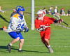 Baldwinsville Bees Dillon Darcangelo (10) workiing against Cazenovia Lakers Cole Willard (24) in Section III Boys Lacrosse action at the Sean M. Googin Memorial Sports Complex in Cazenovia, New York on Tuesday, May 10, 2016.  Cazenovia won 10-8.