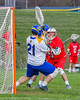 Cazenovia Lakers goalie Brendan Whalen (21) makes a save against the Baldwinsville Bees in Section III Boys Lacrosse action at the Sean M. Googin Memorial Sports Complex in Cazenovia, New York on Tuesday, May 10, 2016.  Cazenovia won 10-8.