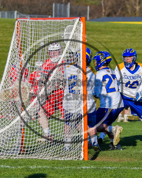 Baldwinsville Bees Charlie Bertrand (6) shoots and scores on the Cazenovia Lakers in Section III Boys Lacrosse action at the Sean M. Googin Memorial Sports Complex in Cazenovia, New York on Tuesday, May 10, 2016.  Cazenovia won 10-8.