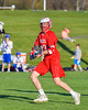 Baldwinsville Bees Peter Fiorni III (13) passing the ball against the Cazenovia Lakers in Section III Boys Lacrosse action at the Sean M. Googin Memorial Sports Complex in Cazenovia, New York on Tuesday, May 10, 2016.  Cazenovia won 10-8.