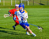 Cazenovia Lakers Adam Race (2) with the ball against the Baldwinsville Bees in Section III Boys Lacrosse action at the Sean M. Googin Memorial Sports Complex in Cazenovia, New York on Tuesday, May 10, 2016.  Cazenovia won 10-8.