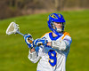 Cazenovia Lakers Thomas Bragg (9) looking to make a play against the Baldwinsville Bees in Section III Boys Lacrosse action at the Sean M. Googin Memorial Sports Complex in Cazenovia, New York on Tuesday, May 10, 2016.  Cazenovia won 10-8.