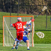 Cazenovia Lakers goalie Brendan Whalen (21) passes the ball around Baldwinsville Bees Ryan Gebhardt (20) in Section III Boys Lacrosse action at the Sean M. Googin Memorial Sports Complex in Cazenovia, New York on Tuesday, May 10, 2016.  Cazenovia won 10-8.