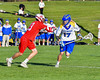 Baldwinsville Bees Peter Fiorni III (13) defending against Cazenovia Lakers Alex Nowak (17) in Section III Boys Lacrosse action at the Sean M. Googin Memorial Sports Complex in Cazenovia, New York on Tuesday, May 10, 2016.  Cazenovia won 10-8.