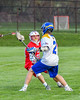 Baldwinsville Bees Mitch Warren (22) defending against Cazenovia Lakers Adam Race (2) in Section III Boys Lacrosse action at the Sean M. Googin Memorial Sports Complex in Cazenovia, New York on Tuesday, May 10, 2016.  Cazenovia won 10-8.
