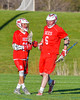 Baldwinsville Bees Charlie Bertrand (6) gets congratulated for his goal against the Cazenovia Lakers by Ryan Gebhardt (20) in Section III Boys Lacrosse action at the Sean M. Googin Memorial Sports Complex in Cazenovia, New York on Tuesday, May 10, 2016.  Cazenovia won 10-8.