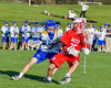 Baldwinsville Bees Brandon Kohutanich (25) being defended by Cazenovia Lakers Derek White (31) in Section III Boys Lacrosse action at the Sean M. Googin Memorial Sports Complex in Cazenovia, New York on Tuesday, May 10, 2016.  Cazenovia won 10-8.