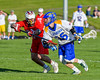 Baldwinsville Bees John Petrelli (33) defending against Cazenovia Lakers Jake Lewis (26) in Section III Boys Lacrosse action at the Sean M. Googin Memorial Sports Complex in Cazenovia, New York on Tuesday, May 10, 2016.  Cazenovia won 10-8.