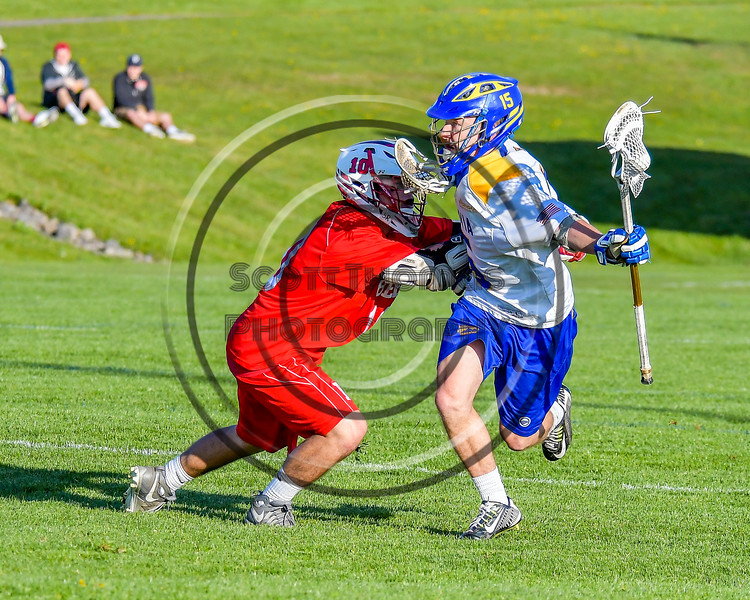 Baldwinsville Bees Dillon Darcangelo (10) defending against Cazenovia Lakers Jake Stowell (15) in Section III Boys Lacrosse action at the Sean M. Googin Memorial Sports Complex in Cazenovia, New York on Tuesday, May 10, 2016.  Cazenovia won 10-8.