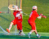 Baldwinsville Bees goalie Riley Smith (35) makes a save agianst the Cazenovia Lakers in Section III Boys Lacrosse action at the Sean M. Googin Memorial Sports Complex in Cazenovia, New York on Tuesday, May 10, 2016.  Cazenovia won 10-8.
