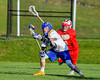 Cazenovia Lakers Brice Basic (1) wins a face-off against Baldwinsville Bees Ryan ingerson (3) in Section III Boys Lacrosse action at the Sean M. Googin Memorial Sports Complex in Cazenovia, New York on Tuesday, May 10, 2016.  Cazenovia won 10-8.
