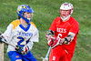 Baldwinsville Bees Charlie Bertrand (6) defending agianst Cazenovia Lakers Cole Willard (24) in Section III Boys Lacrosse action at the Sean M. Googin Memorial Sports Complex in Cazenovia, New York on Tuesday, May 10, 2016.  Cazenovia won 10-8.