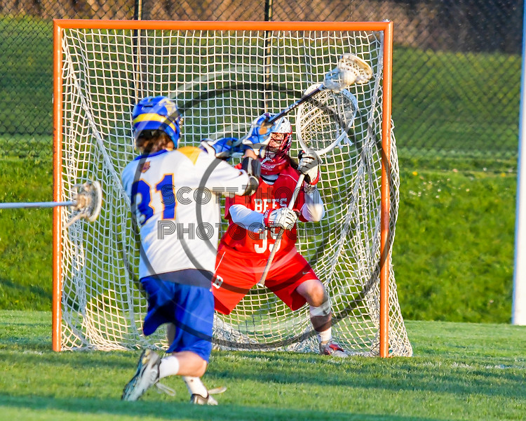 Baldwinsville Bees goalie Riley Smith (35) in goal against the Cazenovia Lakers in Section III Boys Lacrosse action at the Sean M. Googin Memorial Sports Complex in Cazenovia, New York on Tuesday, May 10, 2016.  Cazenovia won 10-8.