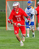 Baldwinsville Bees Peter Fiorni III (13) running with the ball against the Cazenovia Lakers in Section III Boys Lacrosse action at the Sean M. Googin Memorial Sports Complex in Cazenovia, New York on Tuesday, May 10, 2016.  Cazenovia won 10-8.
