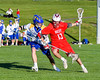 Baldwinsville Bees Peter Fiorni III (13) working against Cazenovia Lakers Adam Race (2) in Section III Boys Lacrosse action at the Sean M. Googin Memorial Sports Complex in Cazenovia, New York on Tuesday, May 10, 2016.  Cazenovia won 10-8.