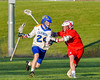 Baldwinsville BeesPatrick Delpha (11) defending against Cazenovia Lakers Cole Willard (24) in Section III Boys Lacrosse action at the Sean M. Googin Memorial Sports Complex in Cazenovia, New York on Tuesday, May 10, 2016.  Cazenovia won 10-8.