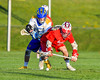 Baldwinsville Bees Ryan ingerson (3) battles for the ball with Cazenovia Lakers Brice Basic (1) in Section III Boys Lacrosse action at the Sean M. Googin Memorial Sports Complex in Cazenovia, New York on Tuesday, May 10, 2016.  Cazenovia won 10-8.