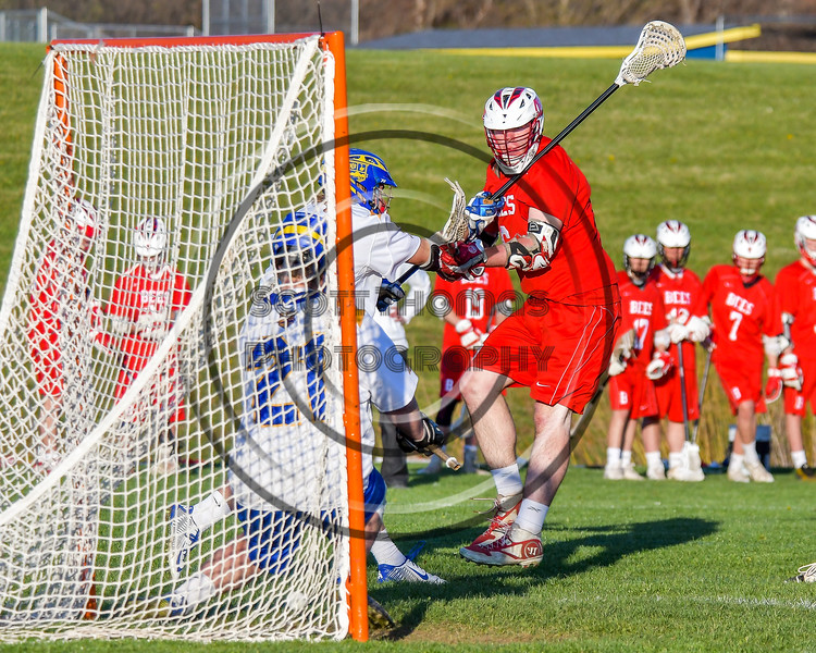 Baldwinsville Bees Charlie Bertrand (6) scores on Cazenovia Lakers goalie Brendan Whalen (21) in Section III Boys Lacrosse action at the Sean M. Googin Memorial Sports Complex in Cazenovia, New York on Tuesday, May 10, 2016.  Cazenovia won 10-8.